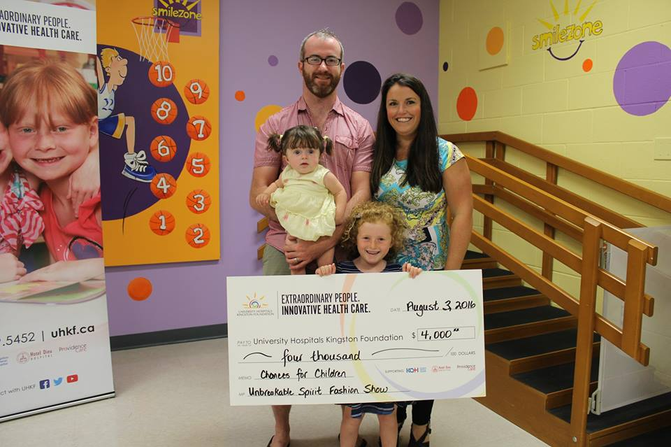 keira and her family holding a cheque