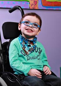 Smiling boy in blue glasses
