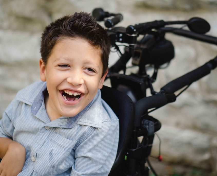Smiling boy in wheelchair