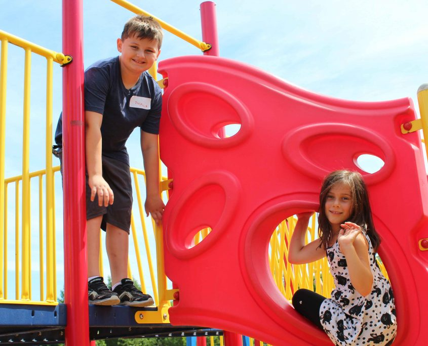 A boy and girl on a play structure