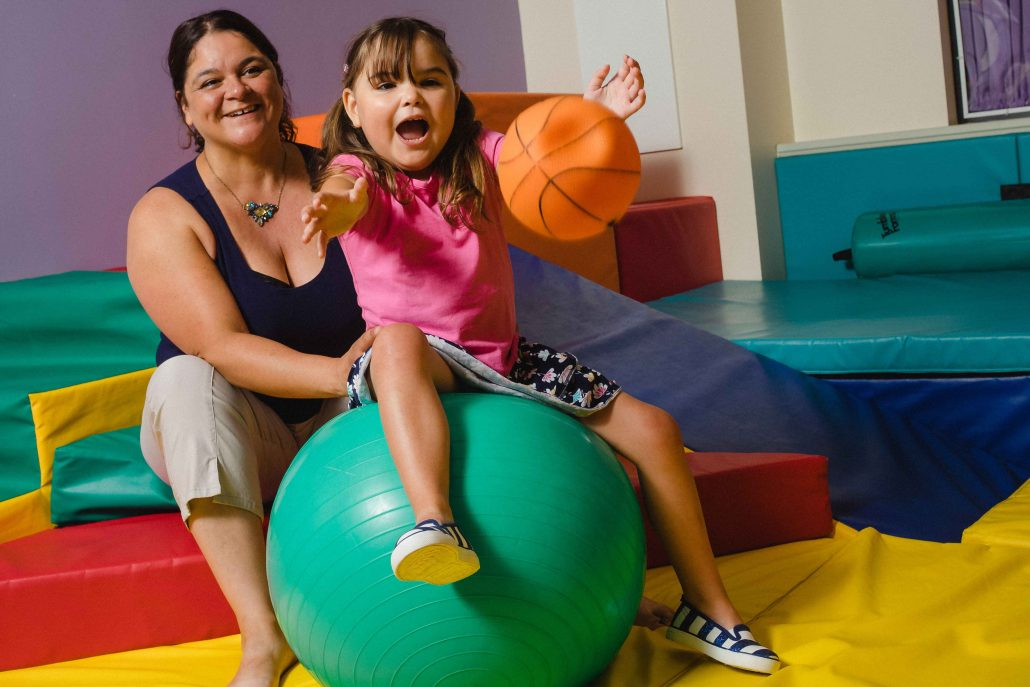 Mother and daughter playing with colourful balls